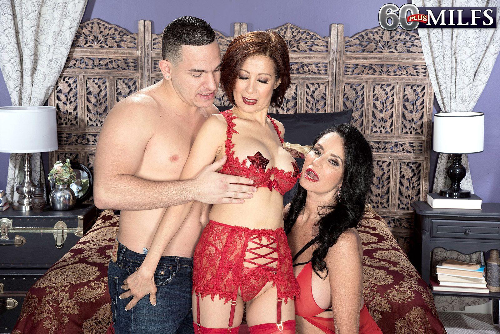 60 plus pornstars Rita Daniels and Kim Anh have a softcore threesome in lingerie