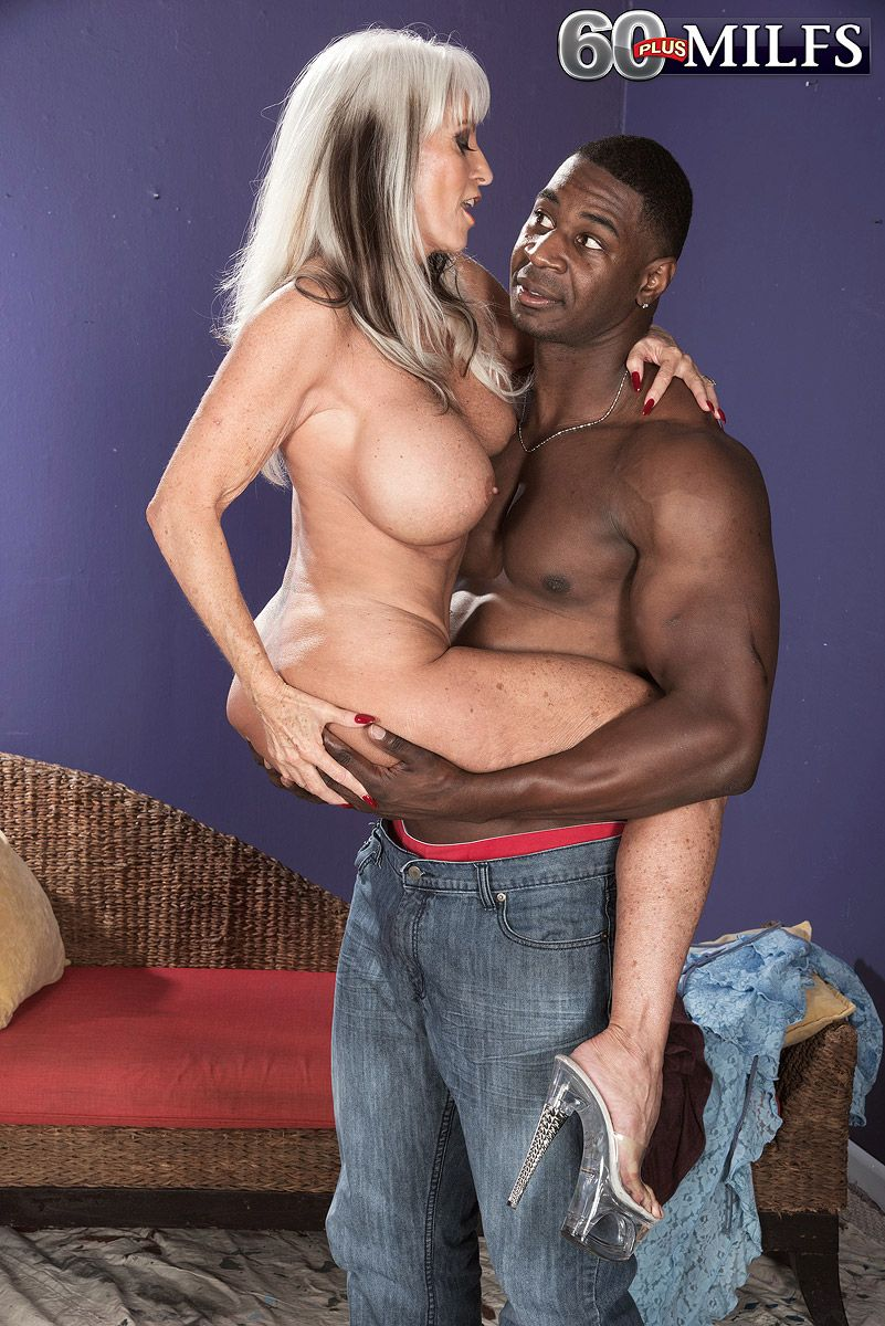 Big boobed mature pornstar Sally D'Angelo bangs a younger black stud