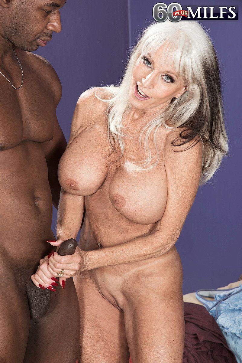 Big boobed mature pornstar Sally D'Angelo bangs a younger black stud