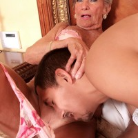 Nylon and lingerie garbed grandma Lola Lee providing big black pecker oral sex with huge breasts out