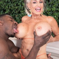 Sex grannie Sally D'Angelo and her hefty titties take on a BIG BLACK DICK outdoors in a Jacuzzi