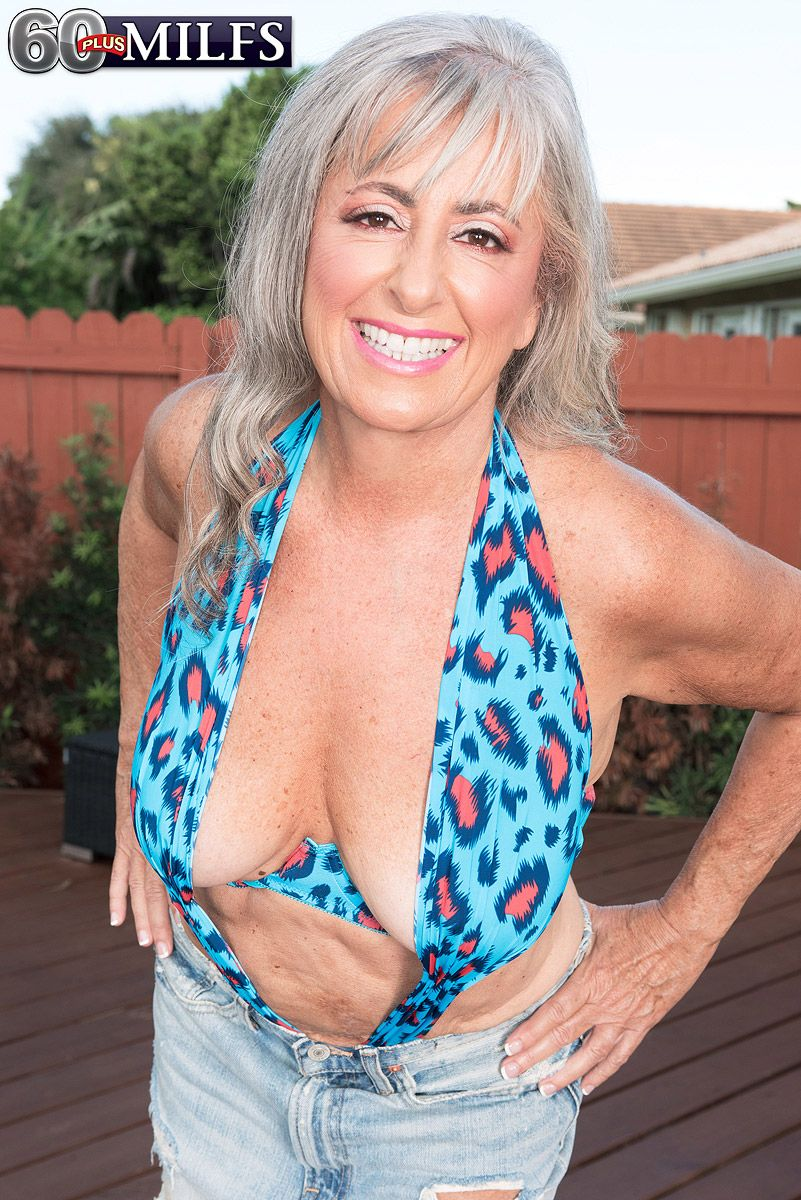 Sexy 60 MILF Silva Foxx entertains a younger guy in a halter top and skirt