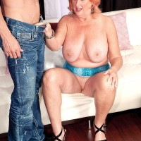 Spindly red-haired grandma Jackie having enormous boobs sucked before giving giant cock oral sex