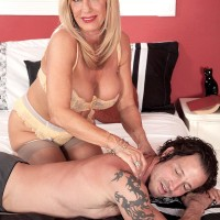 Stocking and lingerie adorned aged XXX flick star Phoenix Skye unleashing big tits and providing massage