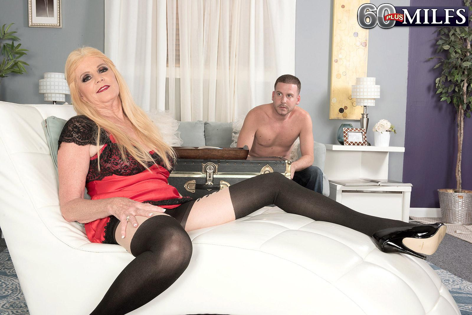 Stocking and lingerie garmented sixty plus platinum-blonde MILF Charlie whipping out huge titties for nip play