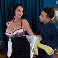 Stocking and miniskirt adorned granny Rita Daniels stripping down to lingerie in work place