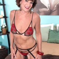 Stocking, garter and lingerie clad 60 plus MILF Sydni Lane letting out butt for sex acts