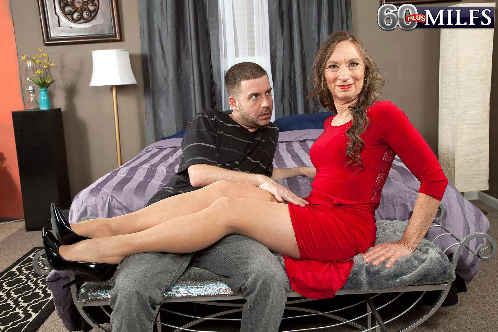 Stockings and high heel garbed granny Mona readying for sex with junior dude