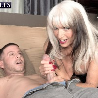 Stripper boot and latex garbed aged XXX star Sally D'Angelo wanking and gobbling huge prick