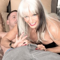 Sandy-haired granny Scarlet Andrews exposing immense boobies before cuck spouse