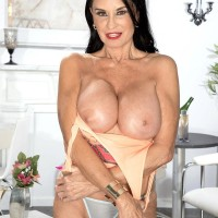 Top mature XXX flick starlet Rita Daniels unveils her humungous knockers and flashes her panties too