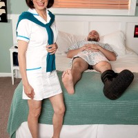 Uniformed 60 plus Asian MILF nurse Kim Anh giving humungous dick handjob in medical center